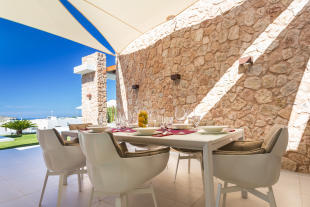 Outdoor dining and living area at Villa Roberta in Ibiza