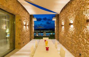 Covered outdoor dining area at Villa Roberta in Ibiza