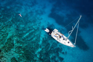 Aerial view of yacht and swimmer off the coast of Mauritius