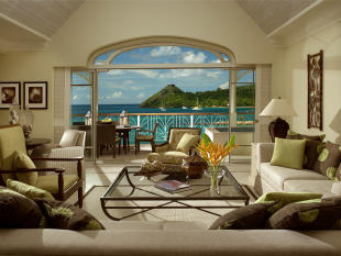 Living room and terrace overlooking the bay and Pigeon Island at The Landings in St Lucia