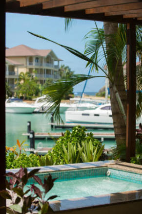 Plunge pool on terrace with views across marina, boats and apartments at The Landings in St Lucia