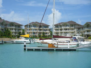 Boat moorings and apartment buildings at The Landings in St Lucia