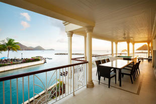 Terrace views across bay at The Landings in St Lucia