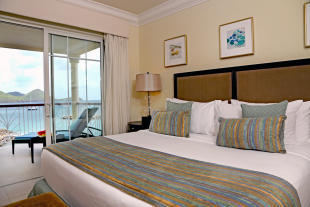Master bedroom with terrace and sea views at The Landings in St Lucia