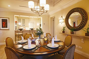 Dining room off kitchen in apartment at The Landings in St Lucia