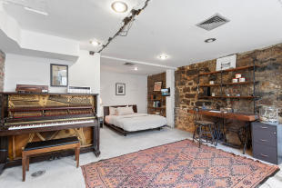 Downstairs bedroom at 550 Grand Street in Brooklyn, New York
