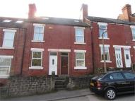 Terraced property in Burcroft Hill...