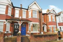 Terraced property in Trentham Street, London...