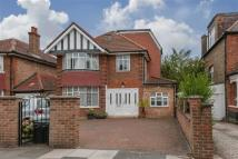 Detached house in Perryn Road, London