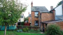 semi detached property in High Street, Harrold