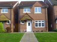 Detached property in Lambourne Court...