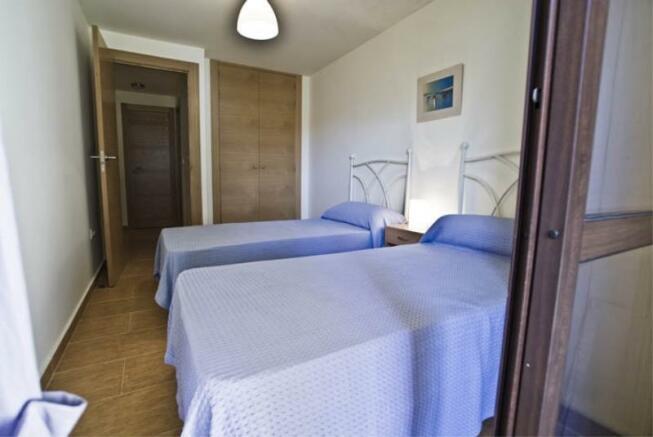 Bedroom 2 w/ terrace & built in wardrobes
