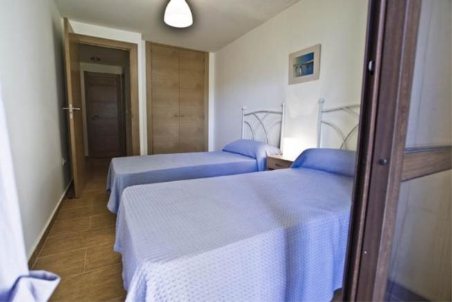 Bedroom 2 on lower level w/wardrobes & terrace