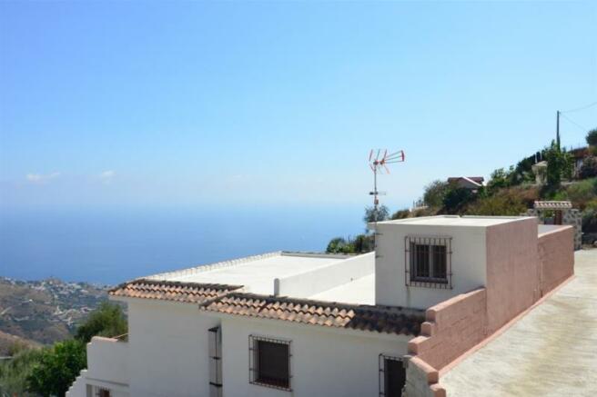 Facade of country villa w/ private pool & seaviews
