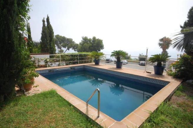 Private pool is on same level as garden & lounge