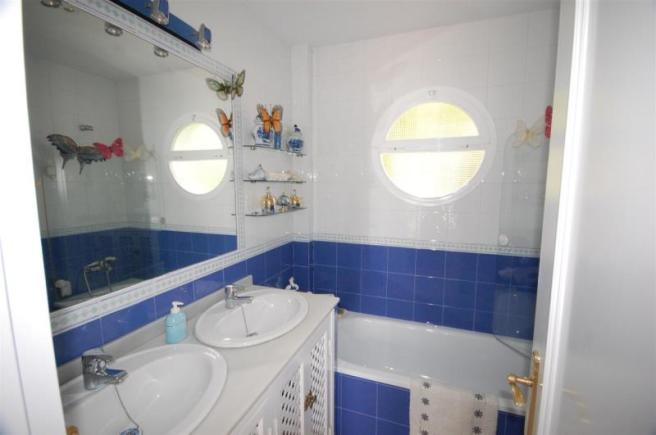 En suite bathroom of main bedroom with double sink