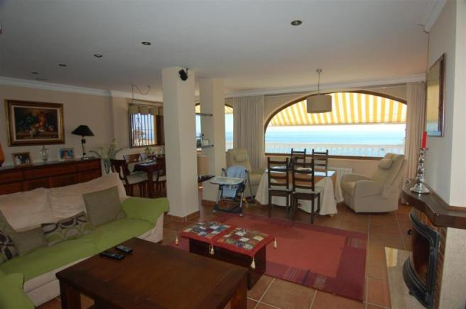 Open plan lounge diner with AC, woodburner & views
