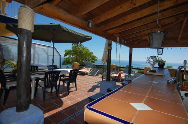 Enjoy this Covered porch with very nice sea views