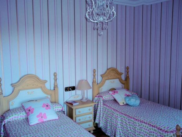 1 of the 4 bedrooms in this pretty family home