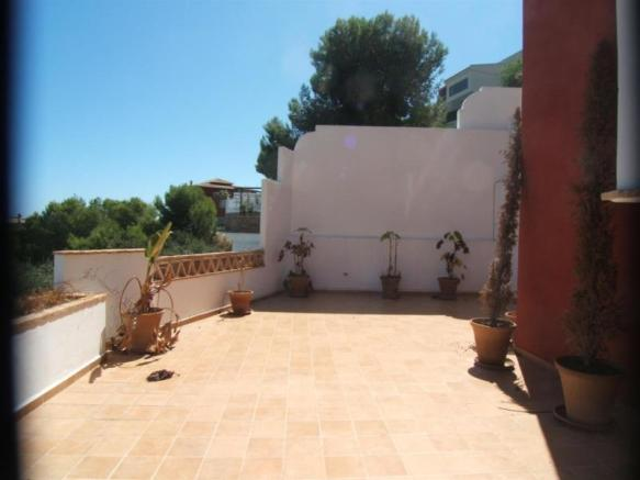 Poolside terrace in this villa in Almunecar Spain