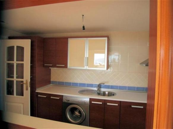 Fitted kitchen with stainless steel appliances
