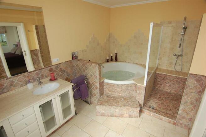 Luxurious main bathroom with double sinks