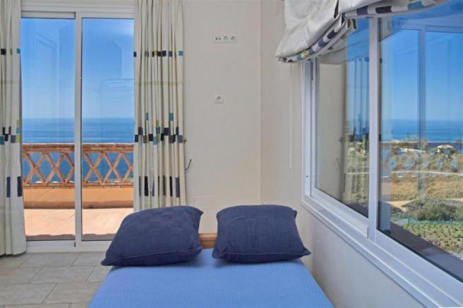 View to sea & mountains from 1 of the bedrooms