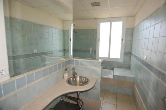 Upstairs family bathroom with tumbled marble