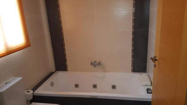 Another bathroom with whirlpool bath