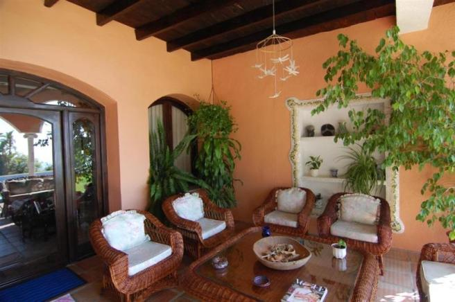 Inviting covered porch off of the lounge