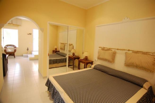 Large bedroom with ensuite bath in guest apartment