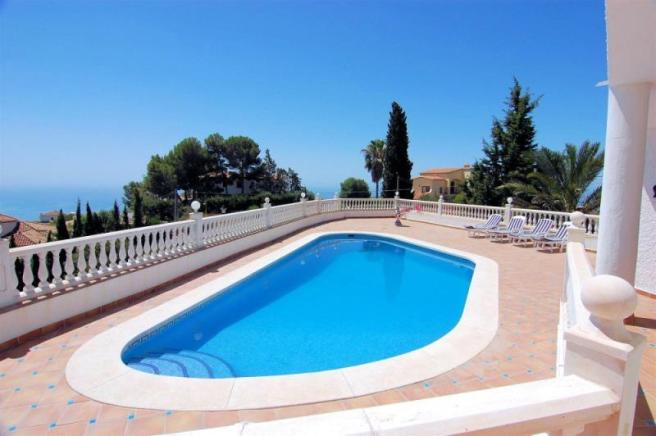 Large, sunny terrace surrounds the pool