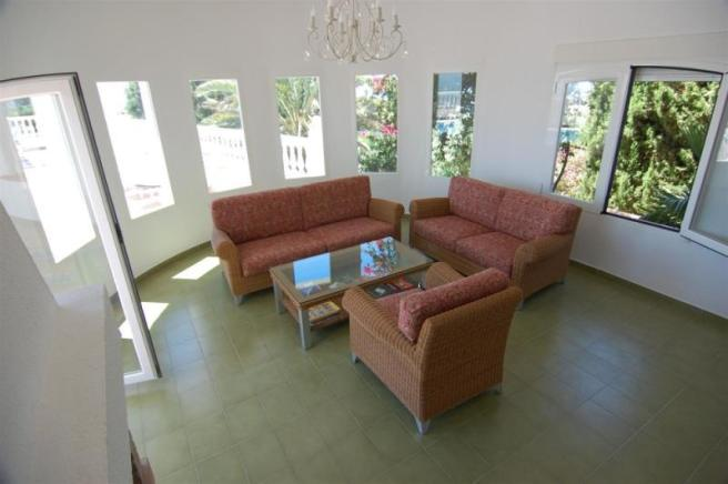 The living areas lead out to the pool terrace