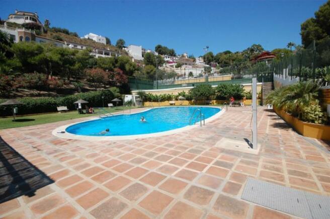 Large communal pool near villa