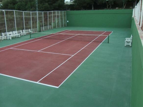 Communal tennis court near villa