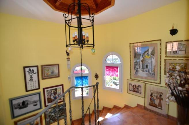 Turret in lounge with vaulted ceiling