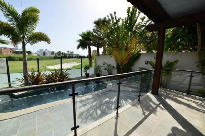 covered terrace,pool area and views to golf course