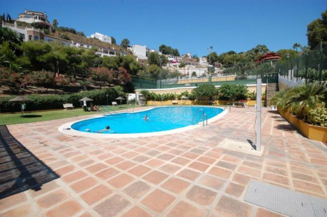 Well maintained, communal pool is open all year