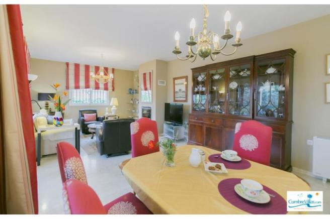 Elegant sitting/dining room with wood burner