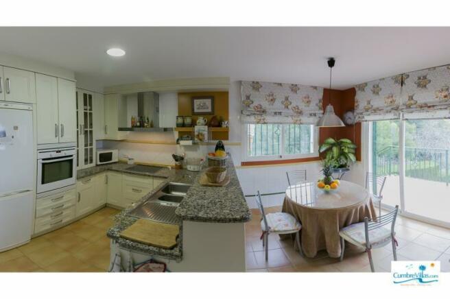 Kitchen has breakfast area & access to terrace