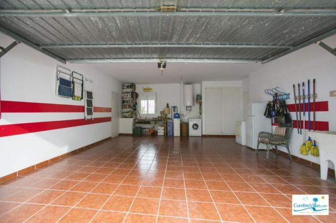Garage has utility area & direct access into villa