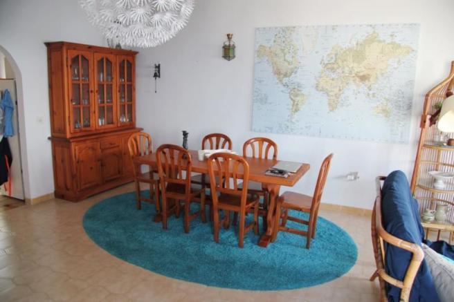 Dining area is bright - kitchen is through arch