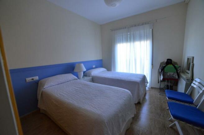 Bedroom with balcony, air con & sea views