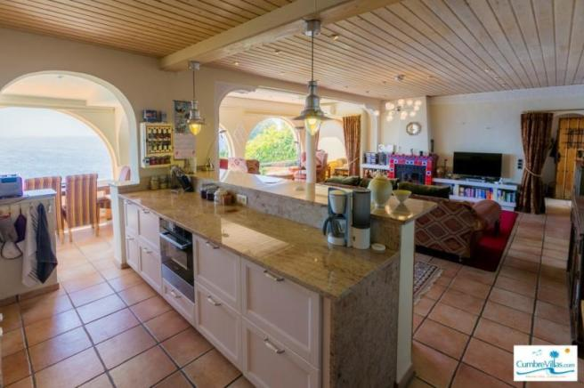 Kitchen integrated into living area & has sea view