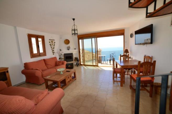 Living area w/wood burner&access to the terrace