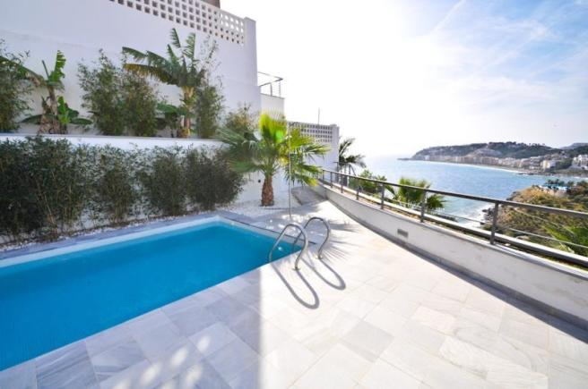 Sunny terrace surrounds private pool