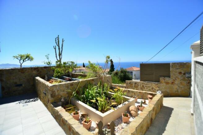 Nice garden at the entrance of the villa