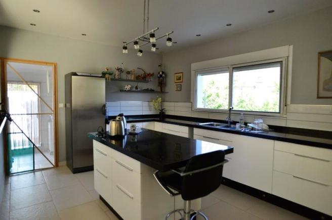 modern, fully fitted kitchen with granite worktops
