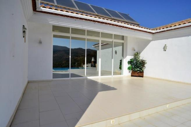 The house has solar panels and underfloor heating