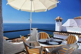 Enjoy meals with a view on terrace off of lounge